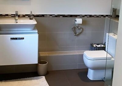 Ms Abbot: New bathroom suite and tiling